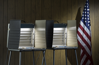 Empty voting booths (Shutterstock)