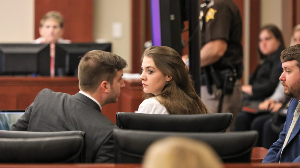 Shayna Hubers looks back as her attorneys talk opening statements during her trial at the Campbell County courthouse on Tuesday August 14, 2018.