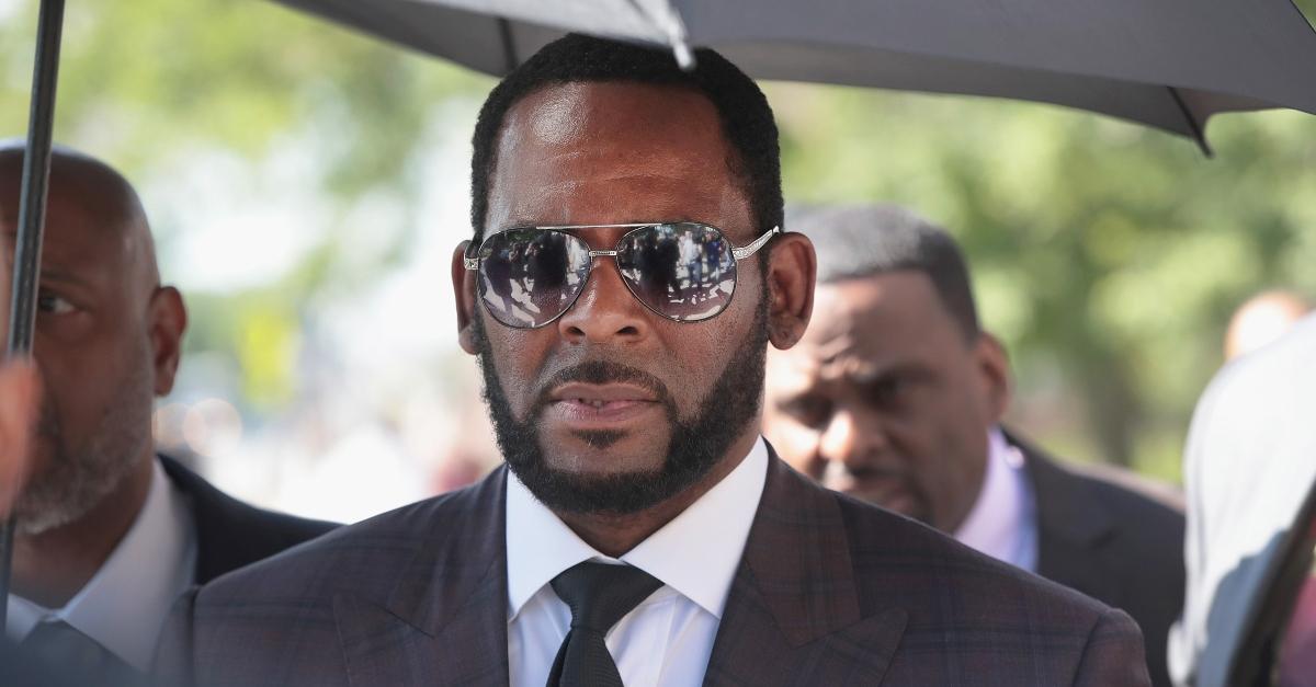 R. Kelly wearing sunglasses