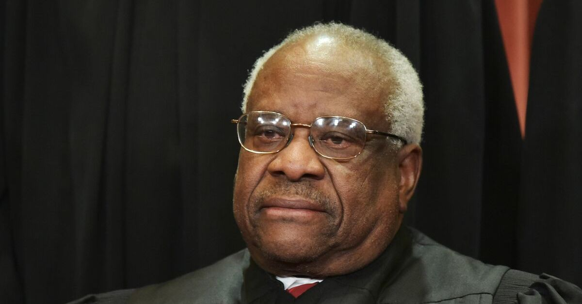 Associate Justice Clarence Thomas poses for the official group photo at the US Supreme Court in Washington, DC on November 30, 2018.