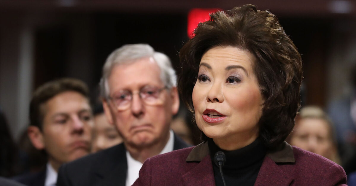 WASHINGTON, DC - JANUARY 11: Elaine Chao testifies during her confirmation hearing to be the next U.S. secretary of transportation before the Senate Commerce, Science and Transportation Committee as her husband, Senate Majority Leader Mitch McConnell (R-KY) (2nd L) looks on, in the Dirksen Senate Office Building on Capitol Hill January 11, 2017 in Washington, DC. Chao, who has previously served as secretary of the Labor Department, was nominated by President-elect Donald Trump.