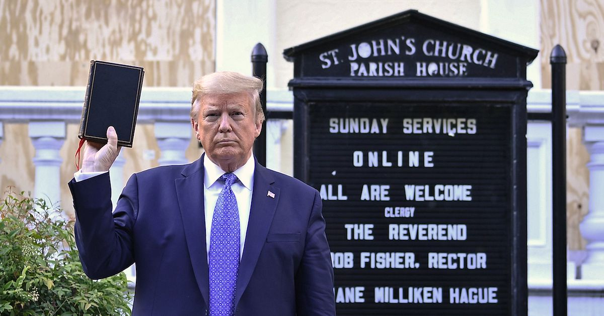 US President Donald Trump holds up a Bible outside of St John's Episcopal church across Lafayette Park in Washington, DC on June 1, 2020. - US President Donald Trump was due to make a televised address to the nation on Monday after days of anti-racism protests against police brutality that have erupted into violence. The White House announced that the president would make remarks imminently after he has been criticized for not publicly addressing in the crisis in recent days.