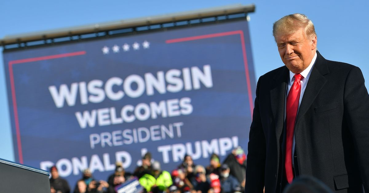 US President Donald Trump arrives to a campaign rally at Green Bay Austin Straubel International Airport in Green Bay, Wisconsin on October 30, 2020. (Photo by MANDEL NGAN / AFP)