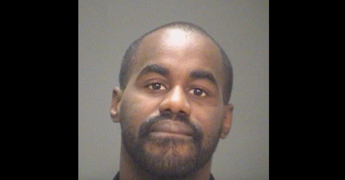 Cornelius Pames appears in a mugshot