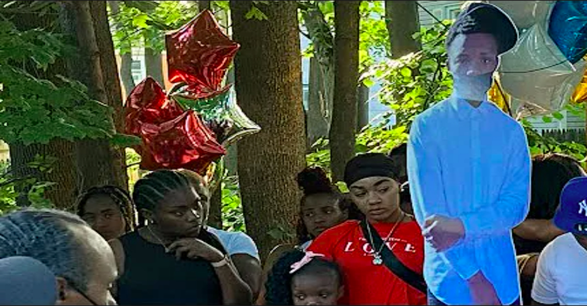 Family and friends gather at a vigil held for 15-year-old murder victim Ny'Kim Young