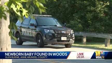 A picture shows police activity at the scene where Olivia Dee-Rose Thompson is accused of abandoning a newborn baby girl in a wooded area off a bike path near the intersection of two residential streets.