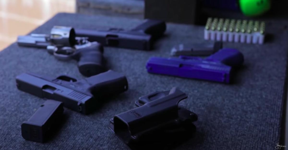multiple handguns on table