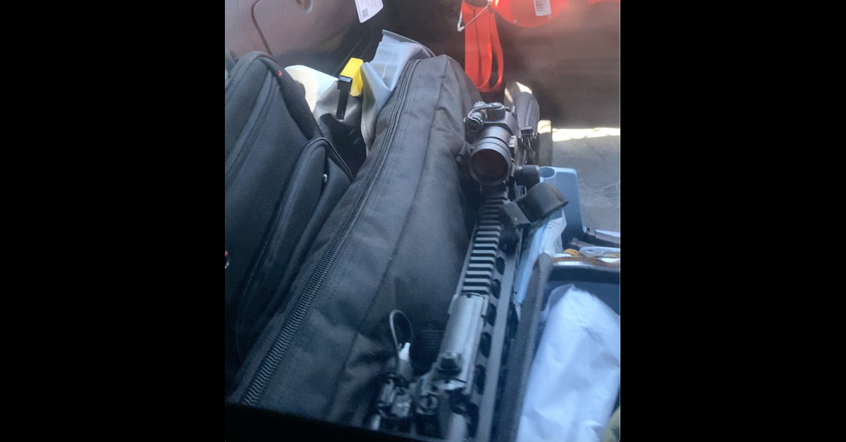 """A so-called """"assault rifle"""" appears in a selfie video which appears to have been recorded by Doffis """"Tre"""" Absher II while he was sitting in a squad car with Aiden Fucci."""