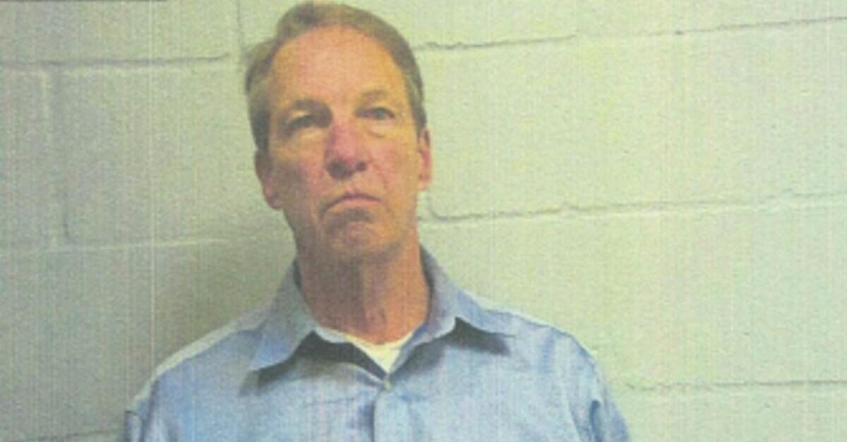 Chris RIchard appears in a mugshot
