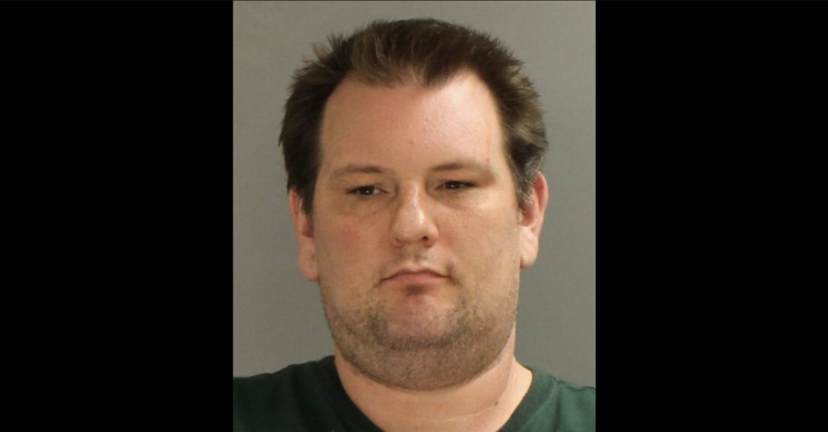 Donald Meshey Jr appears in a mugshot