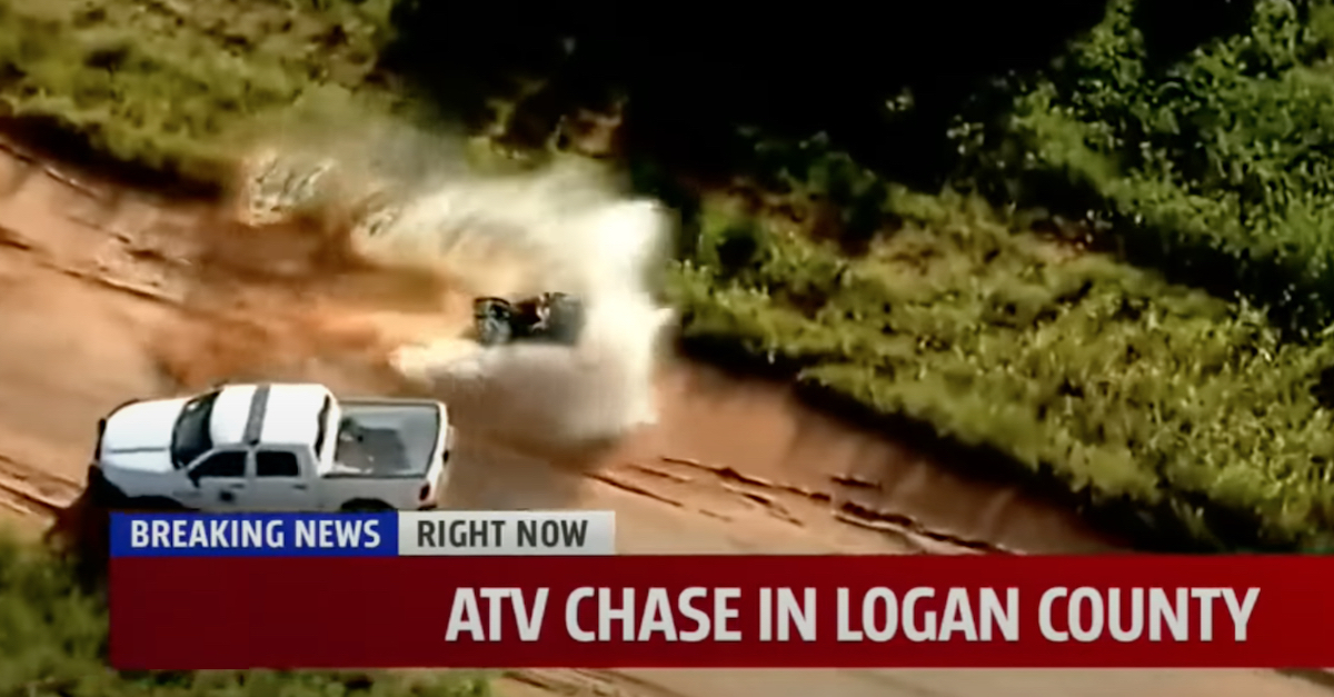 A KFOR-TV screengrab shows Lucas Strider crashing an allegedly stolen ATV by hitting a mud puddle while attempting to avoid a police department truck.