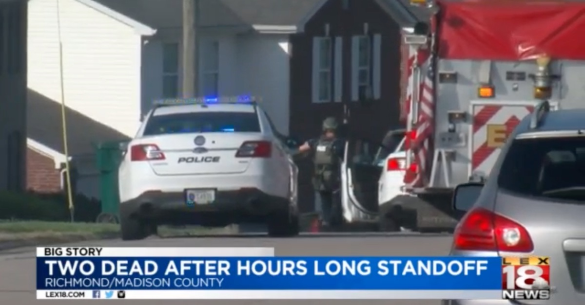 Another screengrab from WLEX-TV shows a police officer outside the crime scene.