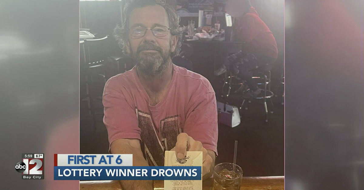 Greg Jarvis shows off his winning lottery ticket