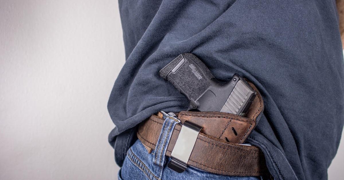 A man open-carrying a pistol