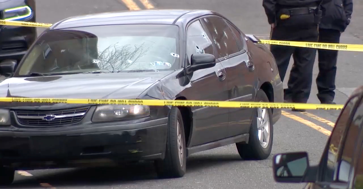 A car positioned in front of a state superior courthouse on Golden Hill Street in Bridgeport, Conn., was shot multiple times on Jan. 27, 2020. (Image via screengrab from WTNH-TV.)