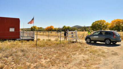 A vehicle from the Office of the Medical Investigator enters the front gate leading to the Bonanza Creek Ranch on October 22, 2021 in Santa Fe, New Mexico. (Photo by Sam Wasson/Getty Images)