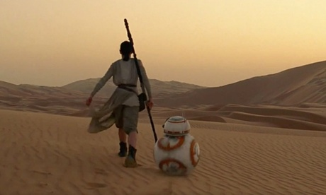 Rey and BB-8 walk into the sunset on Jakku in The Force Awakens