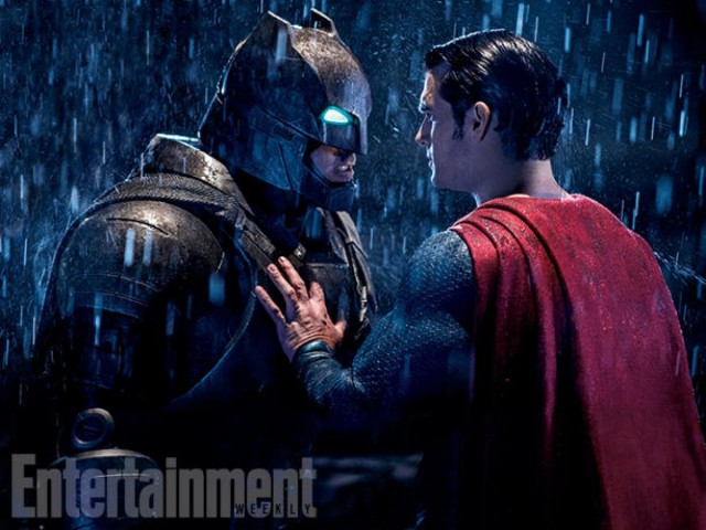 Batman and Superman face each other in the rain