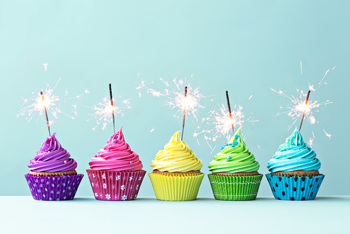 http://www.shutterstock.com/pic-247490812/stock-photo-row-of-colorful-cupcakes-with-sparklers.html?src=csl_recent_image-1