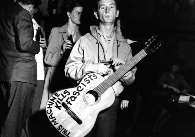 Woody Guthrie and his Fascist-killing guitar ~ 1941.