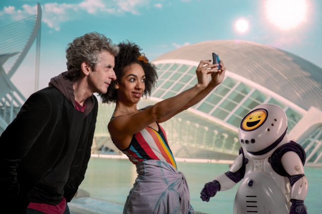 Picture shows: Peter Capaldi as The Doctor, Pearl Mackie as Bill and an Emojibot