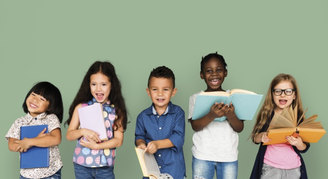 Image: Shutterstock.com A group of children reading books