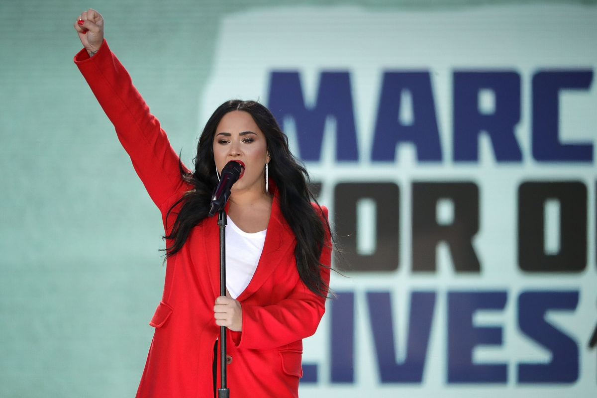 Demi Lovato addresses the March for Our Lives rally on on March 24, 2018 in Washington, DC. Hundreds of thousands of demonstrators, including students, teachers and parents gathered in Washington for the anti-gun violence rally organized by survivors of the Marjory Stoneman Douglas High School school shooting on February 14 that left 17 dead and 17 others wounded. More than 800 related events are taking place around the world to call for legislative action to address school safety and gun violence.