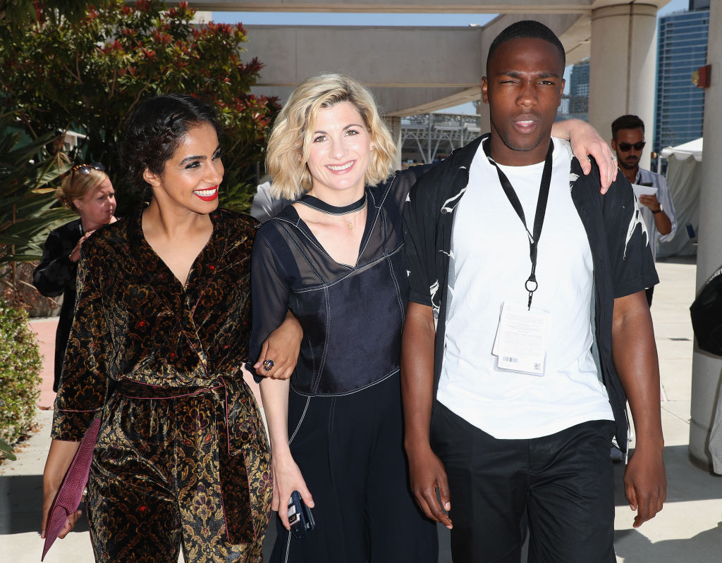 Mandip Gill, Jodie Whittaker, and Tosin Cole pose together.