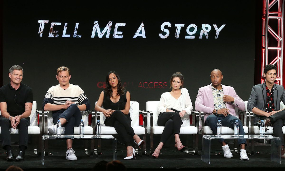 "BEVERLY HILLS, CA - AUGUST 05: (L-R) Executive Producer Kevin Williamson, actor Billy Magnussen, actress Dania Ramirez, actress Daniel Campbell, actor Dorian Missick, and actor Davi Santos of the television show ""Tell Me a Story"" speak during the CBS segment of the Summer 2018 Summer Television Critics Association Press Tour at Beverly Hilton Hotel on August 5, 2018 in Beverly Hills, California."