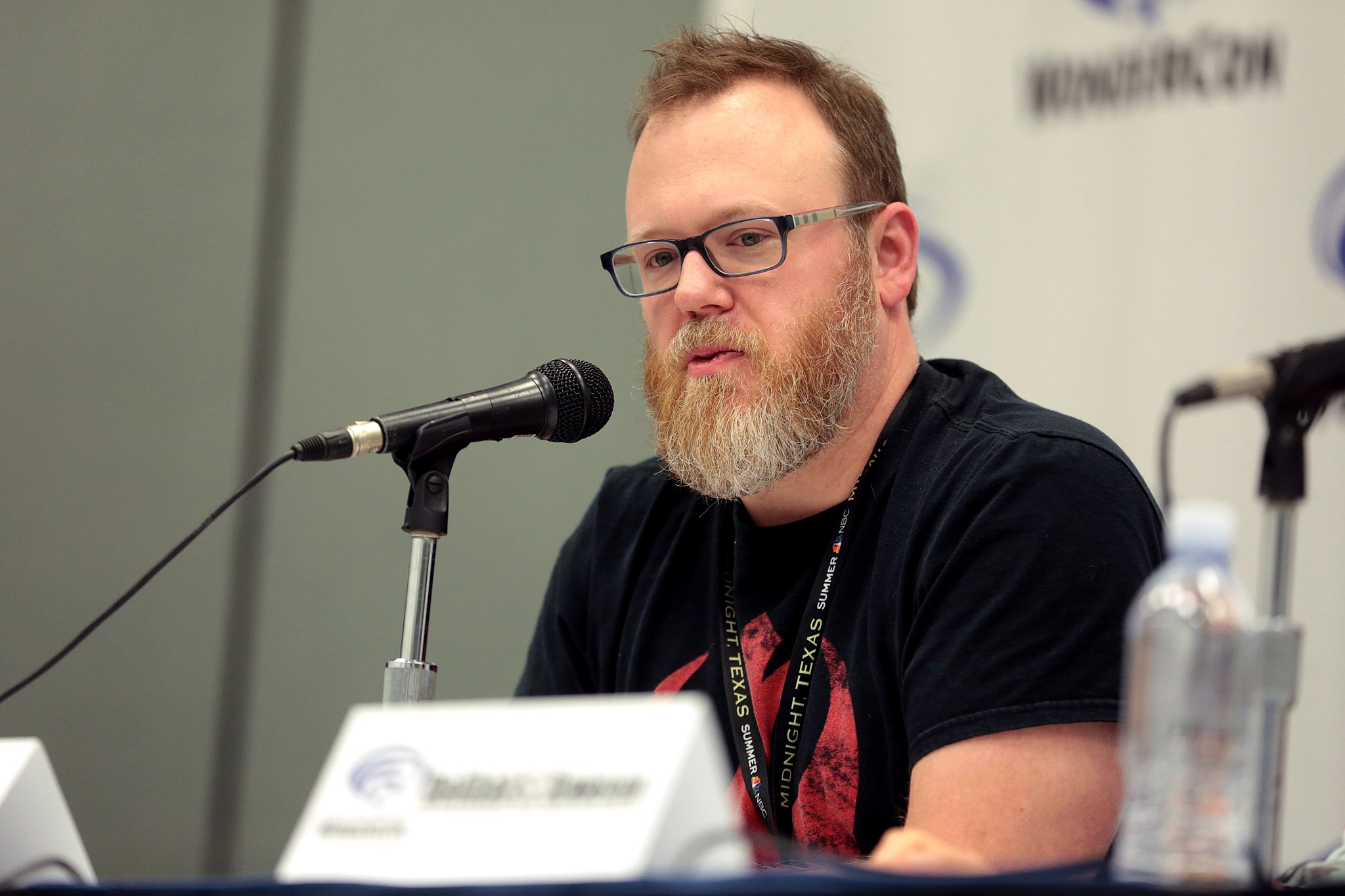 Chuck Wendig speaks at a convention about his work
