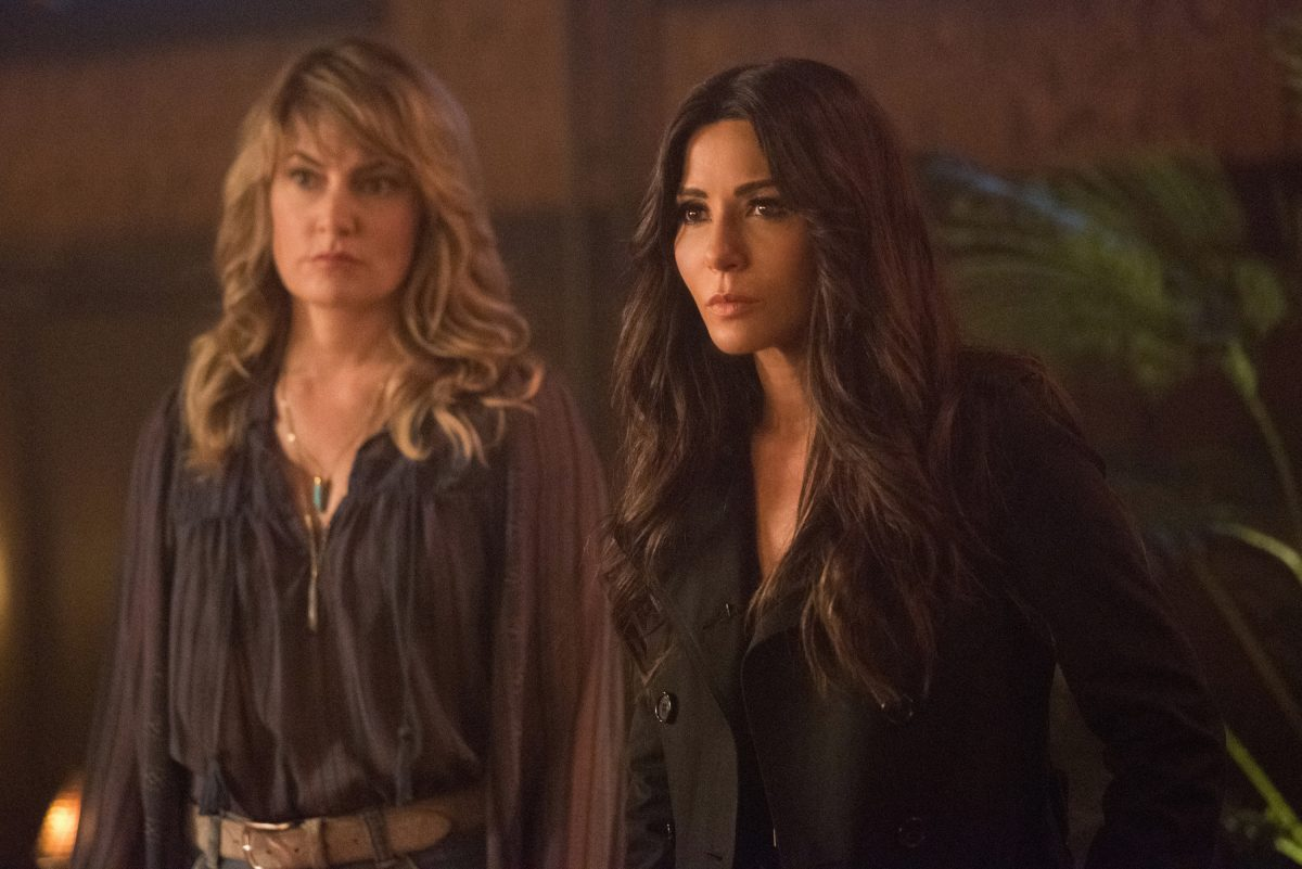 """Riverdale -- """"Chapter Forty-One: Manhunter"""" -- Image Number: RVD306a_0265.jpg -- Pictured (L-R): Madchen Amick as Alice Cooper and Marisol Nichols as Hermione Lodge -- Photo: Dean Buscher/The CW -- © 2018 The CW Network, LLC. All Rights Reserved."""