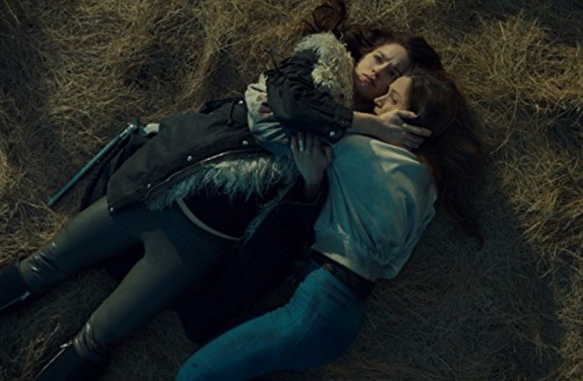 Wynonna Earp and Waverly Earp Hugging on the ground in an episode of the Wynonna Earp.