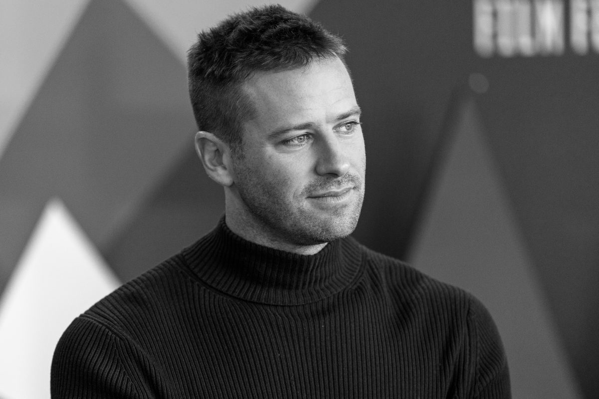 armie hammer in a turtleneck
