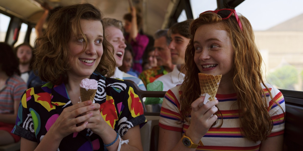 Eleven (Millie Bobby Brown) and Max (Sadie Sink) bond over ice cream in Stranger Things 3.