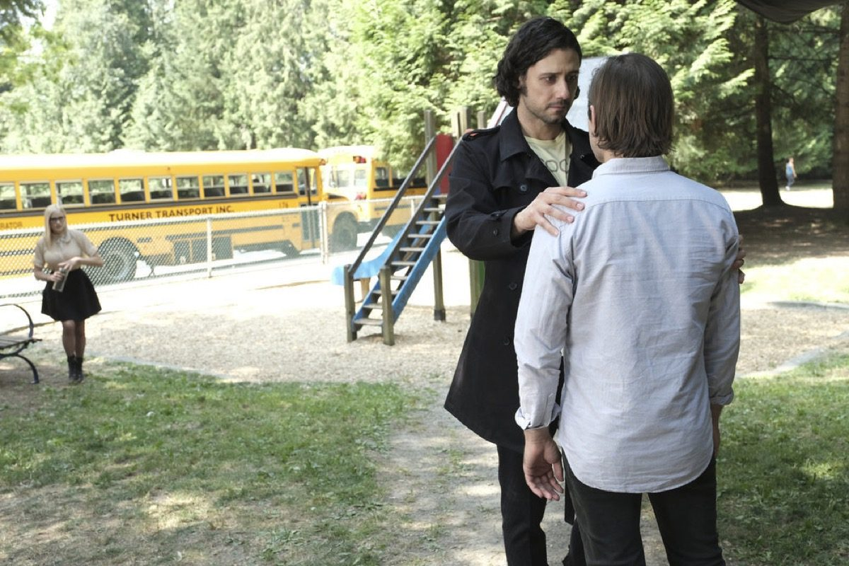 Eliot holds Quentin by the shoulders in The Magicians.
