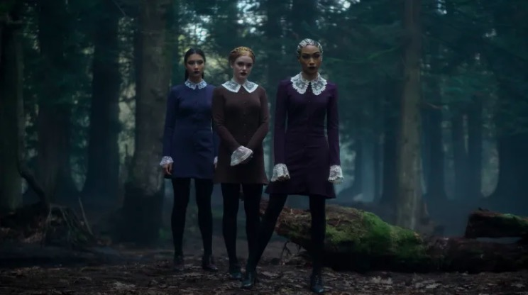 The weird sisters standing in the woods in Chilling Adventures of Sabrina.