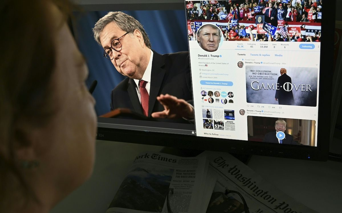 """A photo illustration dated April 18, 2019 in Washington, DC shows an editor looking at a photograph of US Attorney General William Barr (L) speaking about the release of the redacted version of the Mueller report, juxtaposed with US President Donald Trump's latest tweet (R) """"Game Over,"""" using a """"Game of Thrones"""" style montage that pictures him standing in dramatic fog."""