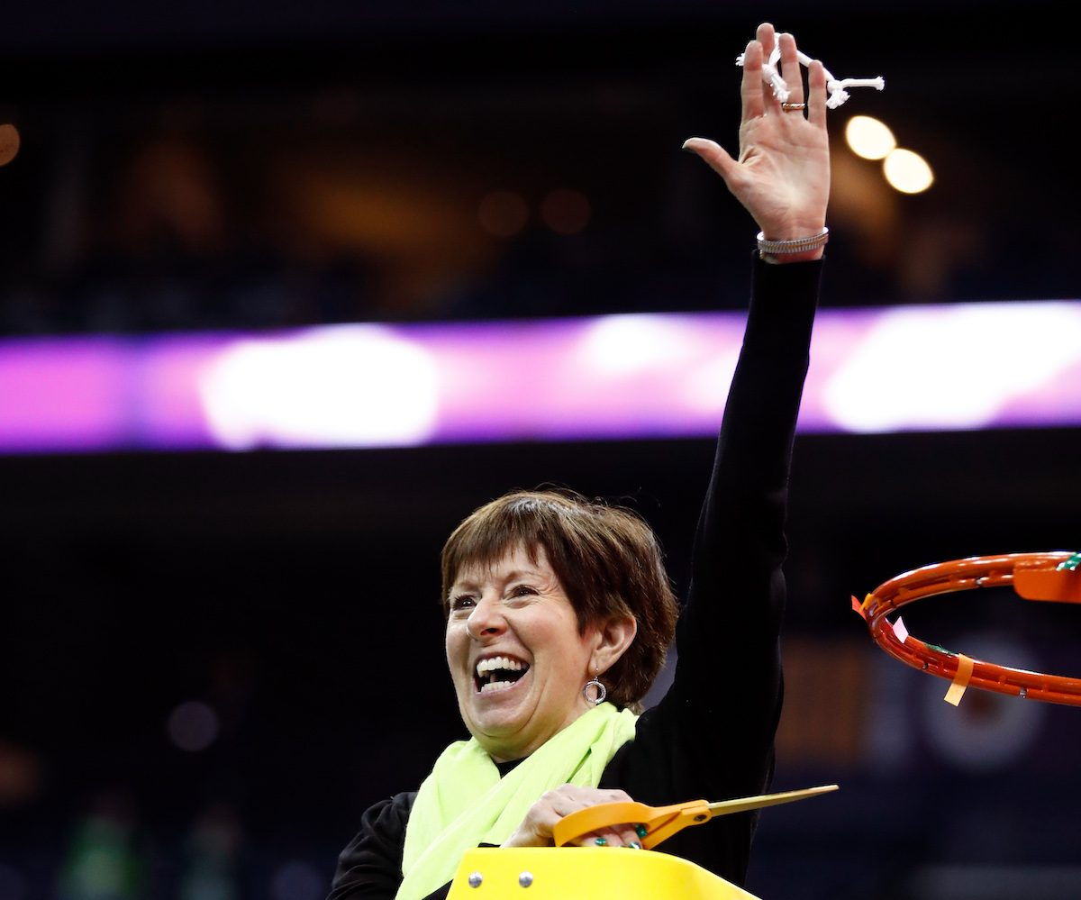 Notre Dame coach Muffet McGraw cuts down the net after a win