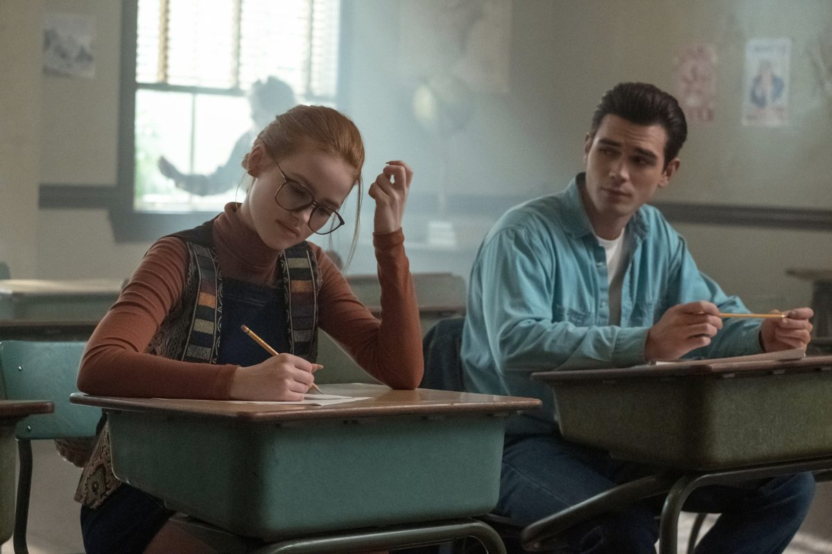 Pictured (L-R): Madelaine Petsch as Teen Penelope Blossom and KJ Apa as Teen Fred Andrews in The CW's Riverdale.
