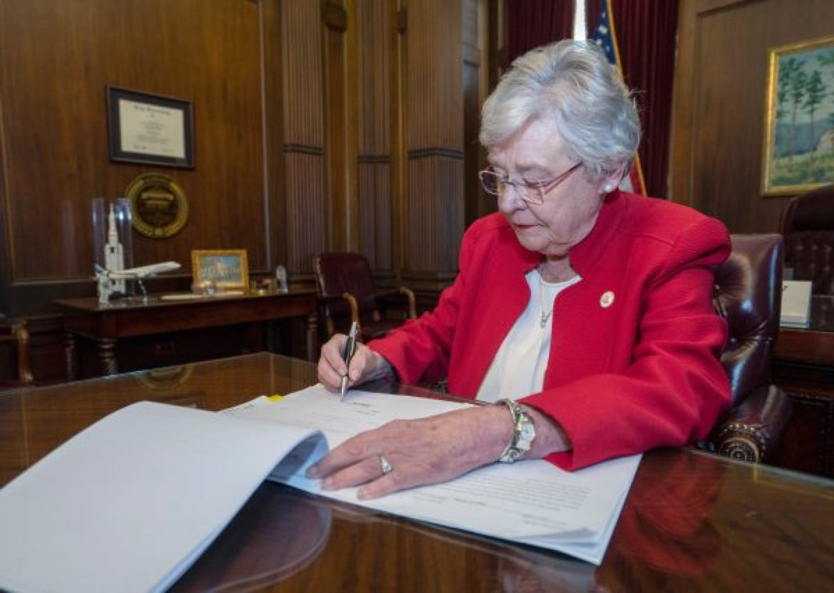 Alabama governor Kay Ivey signs a horrible abortion bill.