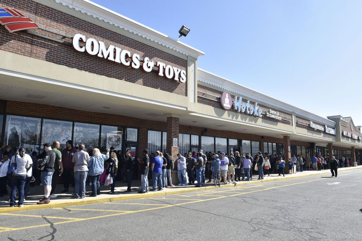 Multitudes of fans gather to celebrate Free Comic Book Day at signing event with DC Entertainment writers Scott Snyder, James Tynin IV and Marguerite Bennett at Fourth World Comics on May 2, 2015 in Smithtown, New York.