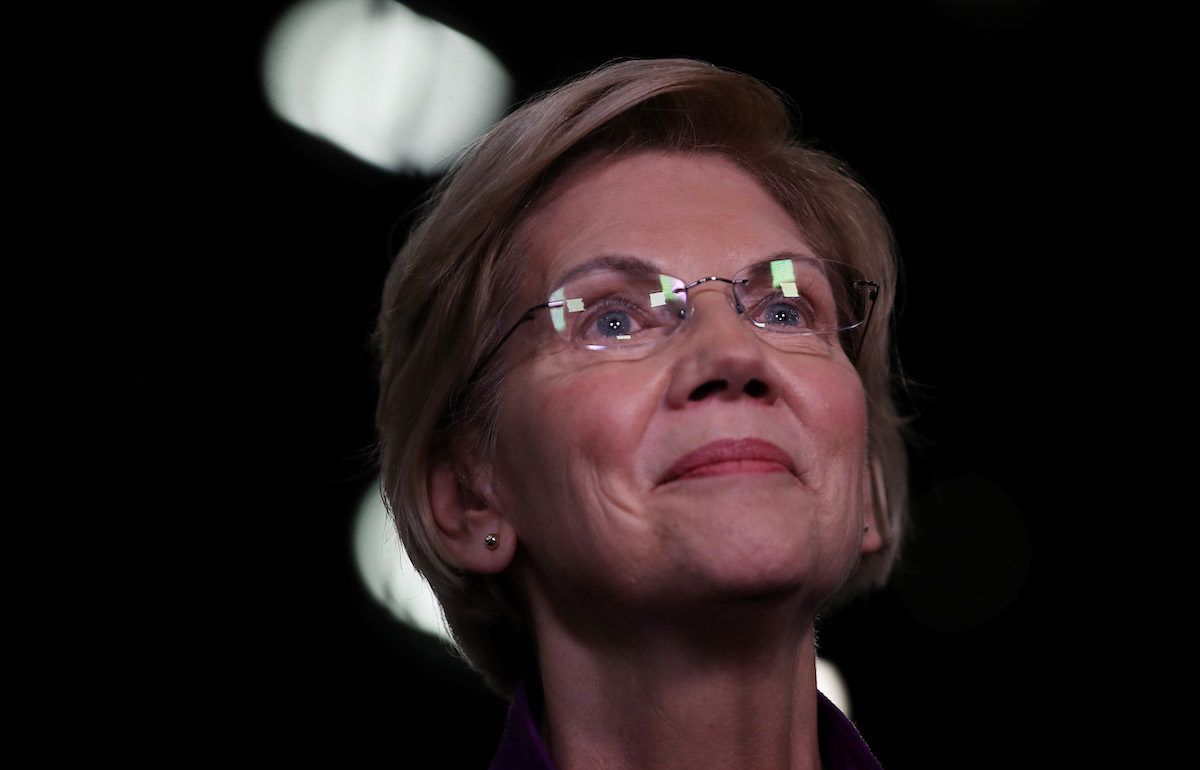 Elizabeth Warren (D-MA) speaks to the media in the spin room after the first night of the Democratic presidential debate