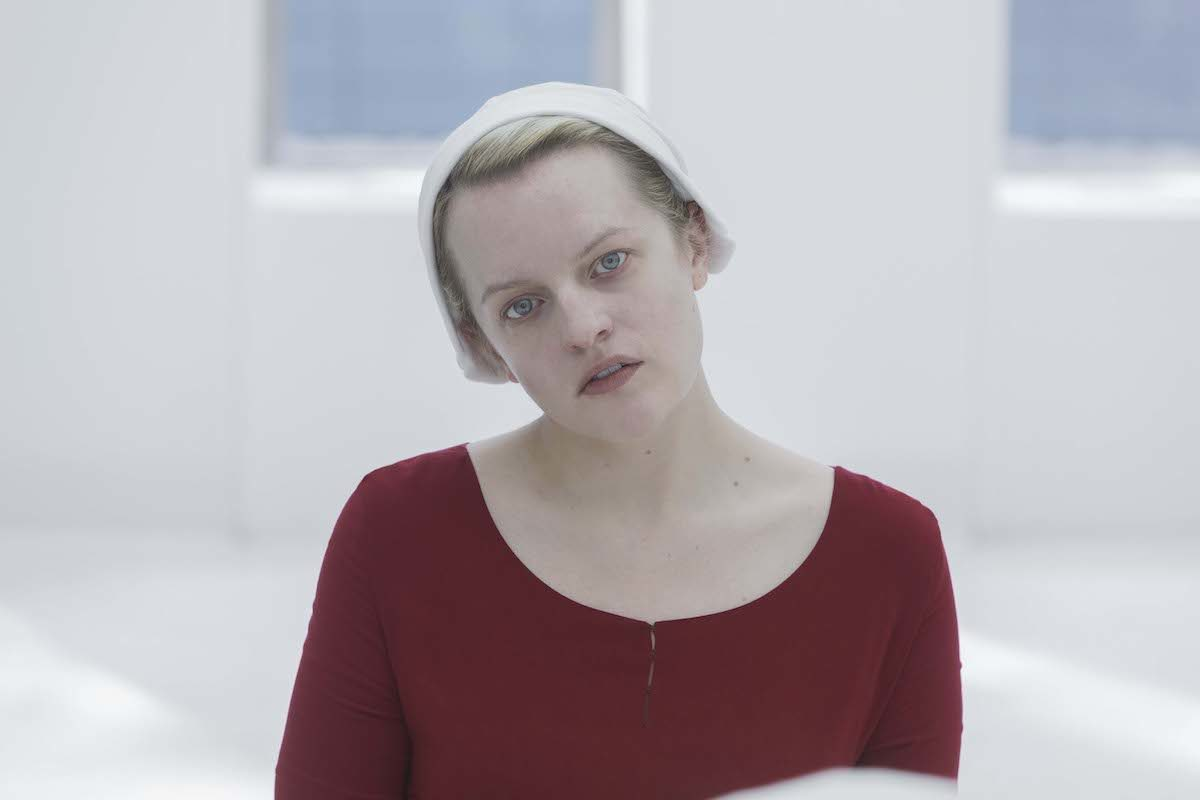 The Handmaid's Tale's June (Elizabeth Moss) stares vacantly in a white room.