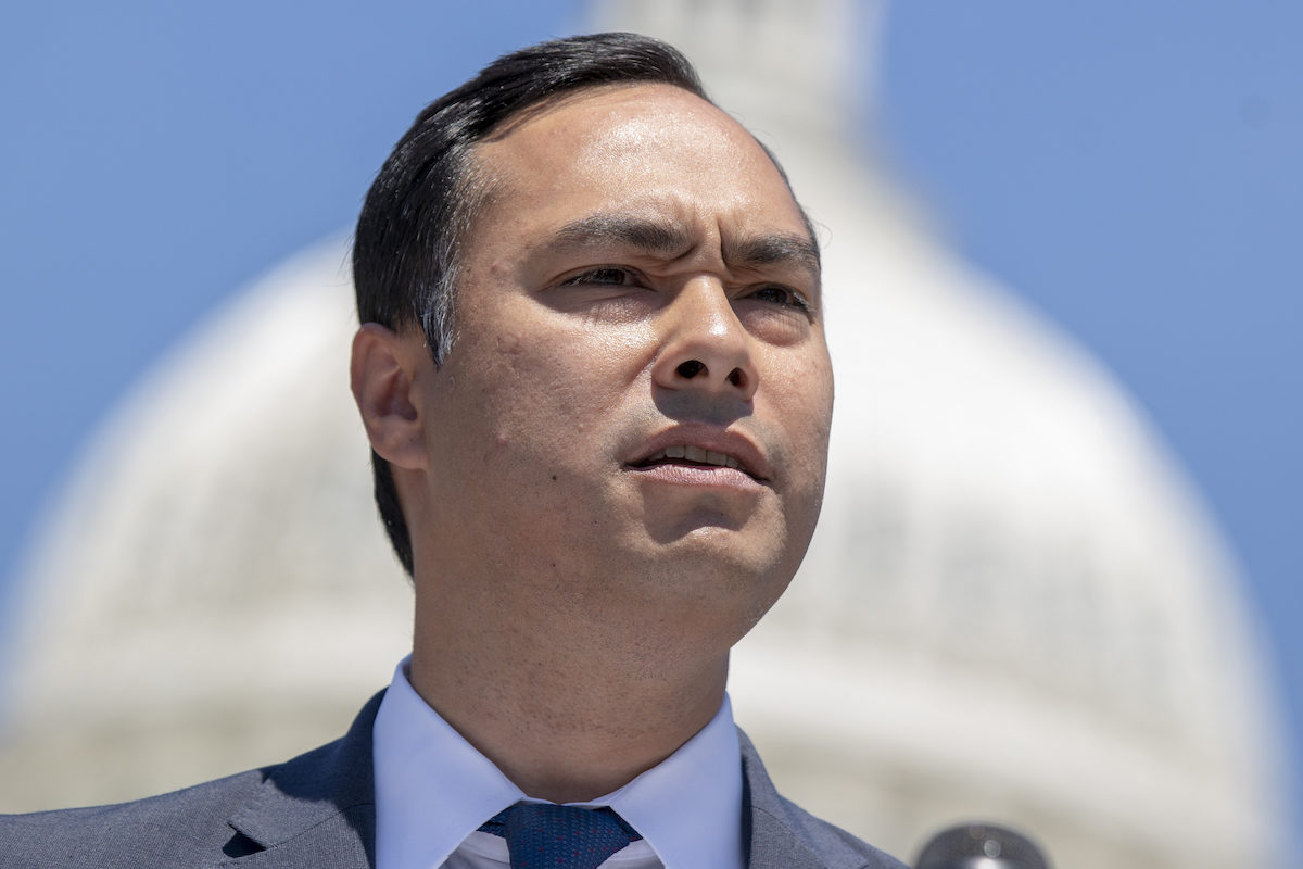 Rep. Joaquin Castro speaks with the Capitol Building in the background.