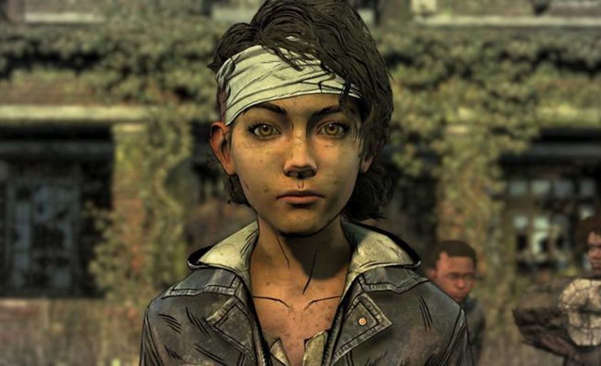 Clementine from the Walking Dead game looks at the camera with her head bandaged.