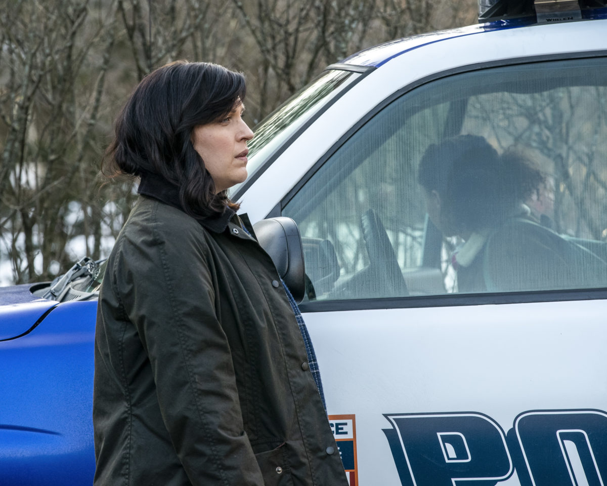 """Alison Tolman by a police car in the pilot of """"Emergence"""""""