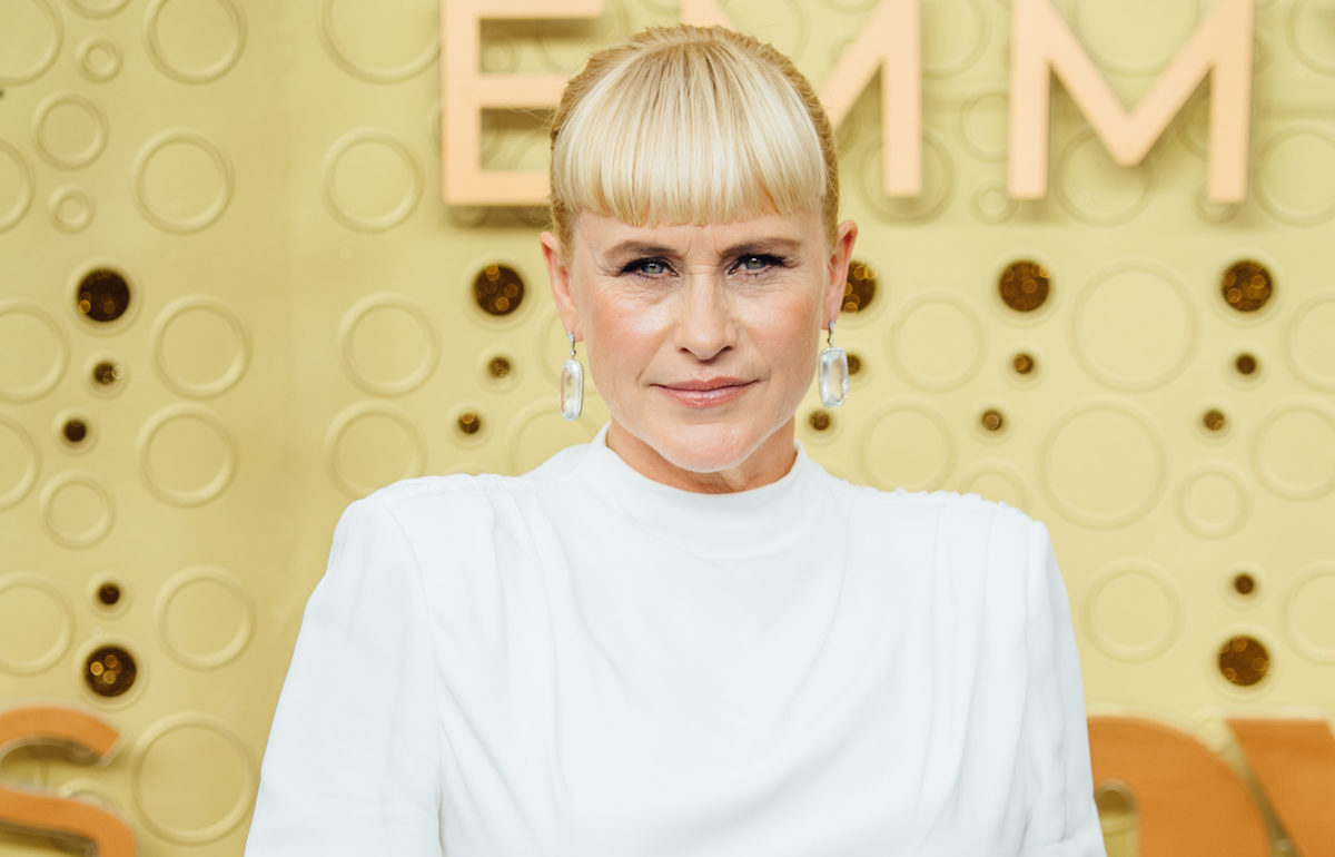Patricia Arquette poses on the Emmys red carpet.