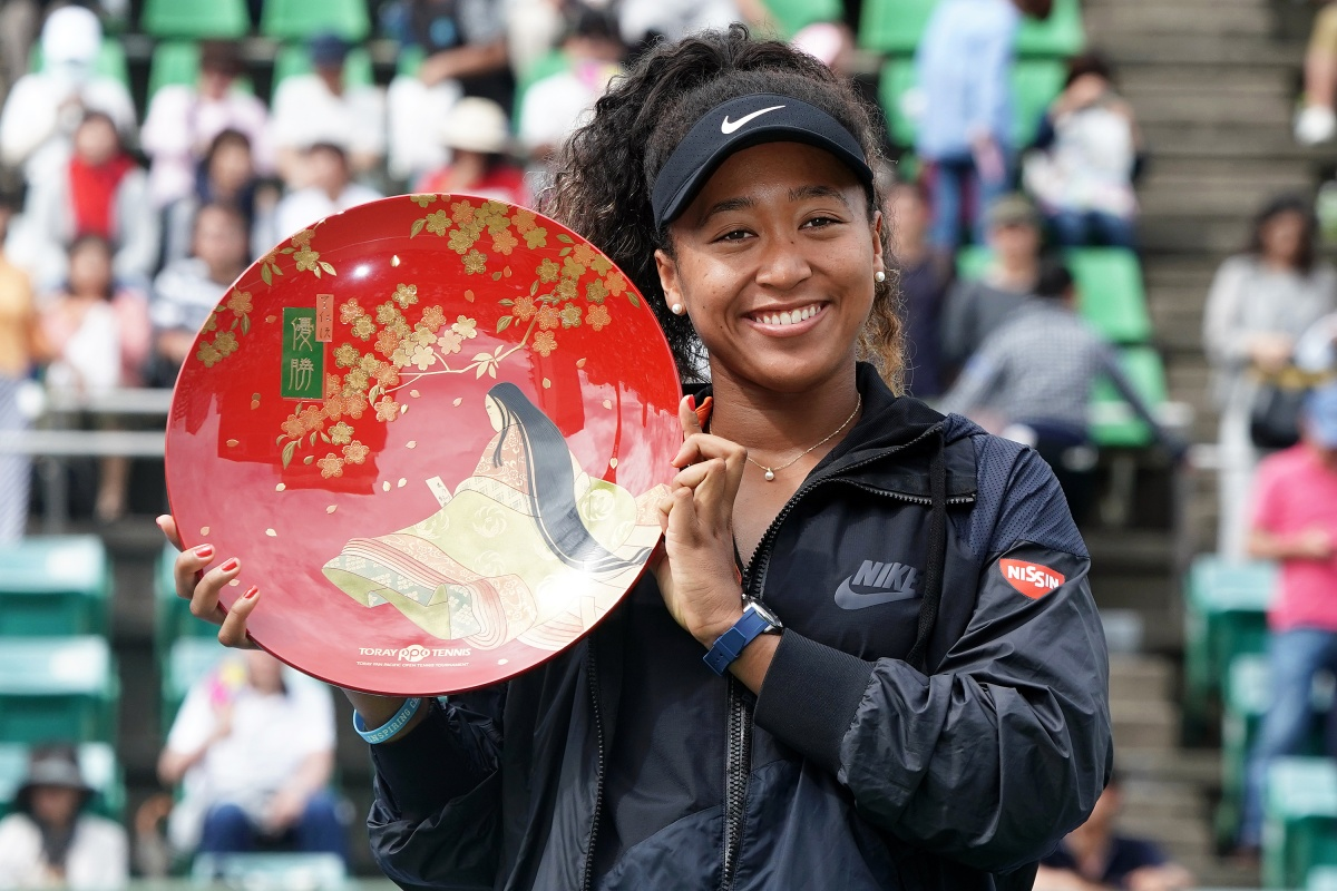Toray Pan Pacific Open - Day 7 OSAKA, JAPAN - SEPTEMBER 22: Singles champion Naomi Osaka of Japan poses for photographs with the trophy after the Singles final agains Anastasia Pavlyuchenkova of Russia during day seven of the Toray Pan Pacific Open at Utsubo Tennis Cent on September 22, 2019 in Osaka, Japan. (Photo by Koji Watanabe/Getty Images)