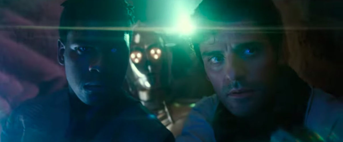 Poe Dameron and Finn stand together in the dark in Star Wars: The Rise of Skywalker trailer.