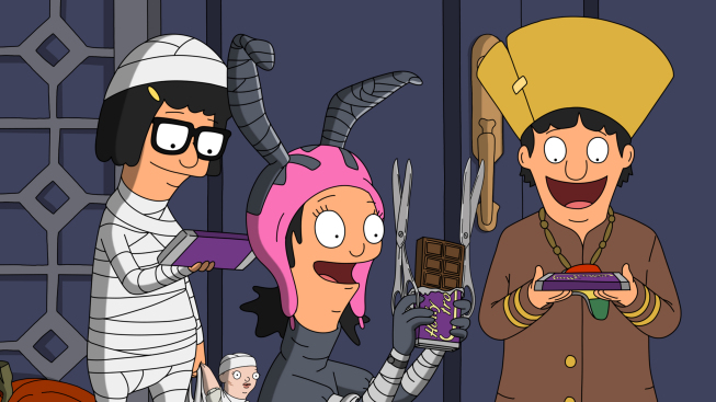 Tina, Louise, and Gene in Halloween costumes with candy in a Halloween episode of Bob's Burgers.